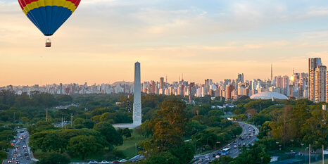 Ibirapuera Park, obelisk and skyscrapers of Sao Paulo